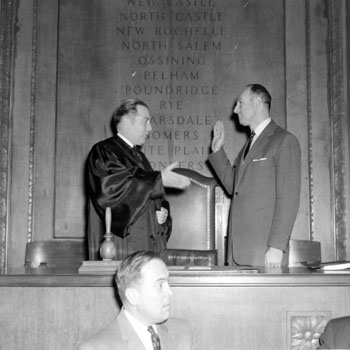 Edwin G. Michaelian taking the oath of office for Westchester County Executive, 1958 (PMC-119)